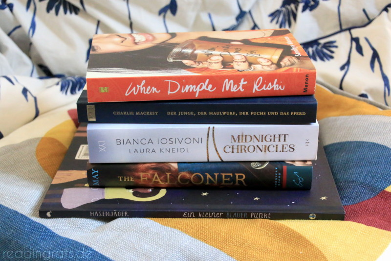 stack of the five books listed below on a pillow